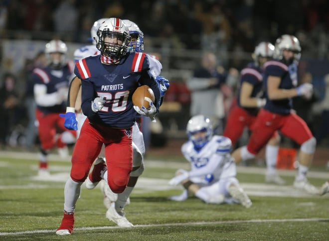 American Leadership Academy Ryan Meza (20) runs in for a touchdown during the 4A semifinal football game against Mesquite High School at American Leadership Academy in Queen Creek on December 4, 2020.