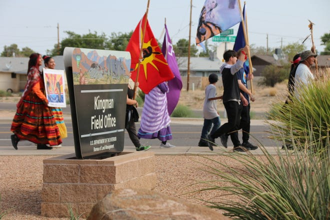 A group of Hualapai and Yavapai people, American Indian Movement members and residents of Wikieup, Arizona, walked to BLM's field office in Kingman to protest a proposed lithium mine in the Big Sandy River watershed which they say would imperil water supplies and a significant cultural site, including the Hakumwe' spring, on Sept. 28, 2021.