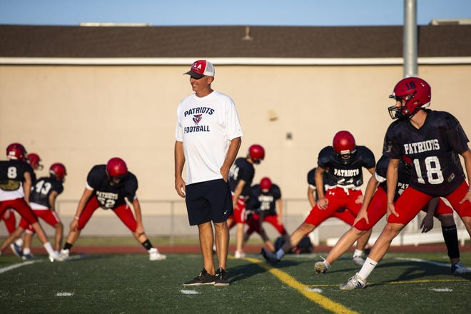 Coach and athletic director Ty Detmer at American Leadership Academy Queen Creek football field on Aug. 24, 2021.