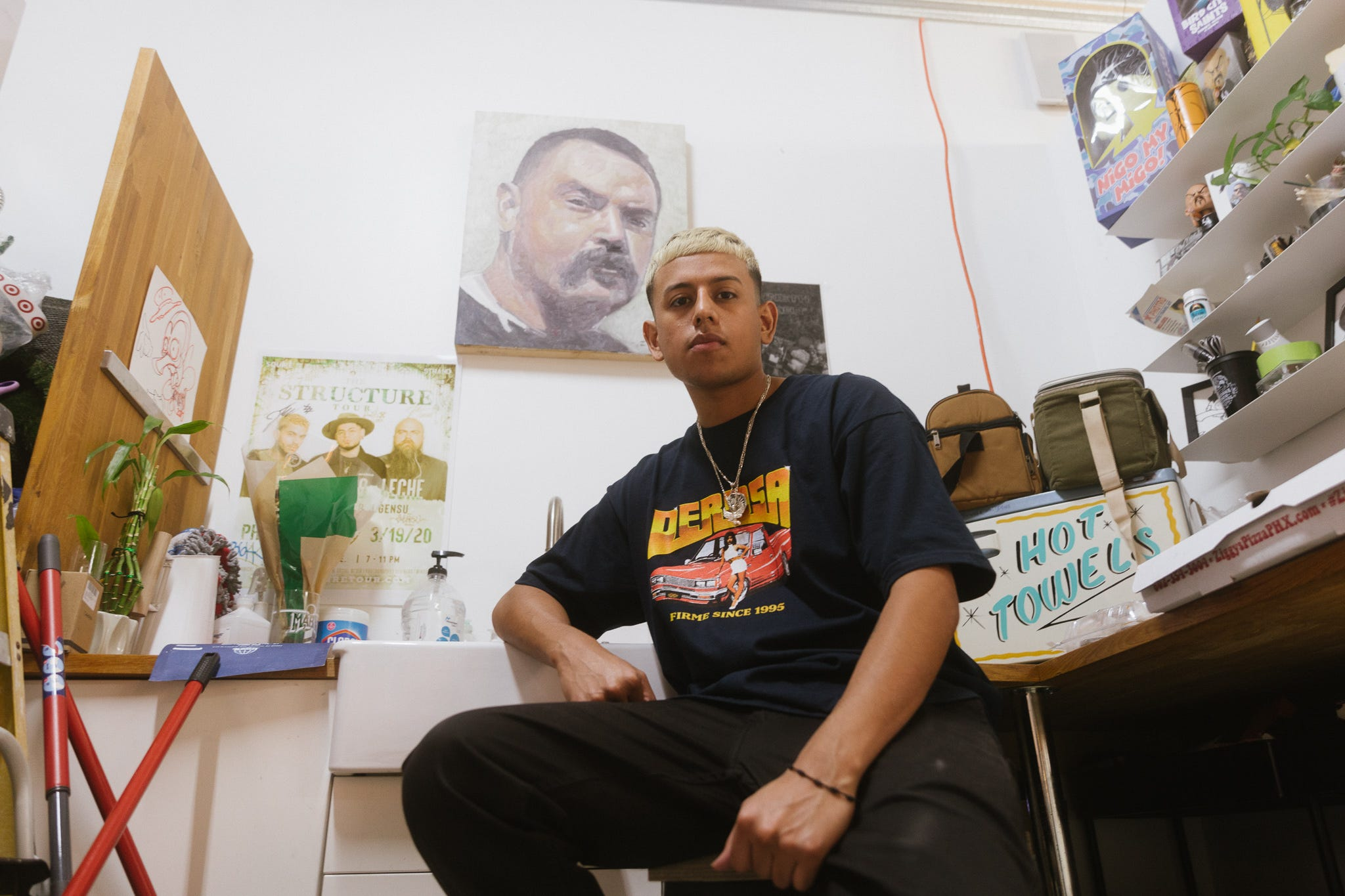 A painting of one Ponce's role models, James Zuniga, hangs in the back of the barbershop. Ponce was gifted the art piece by a local painter knowing how impactful Zuniga had been to Ponce.