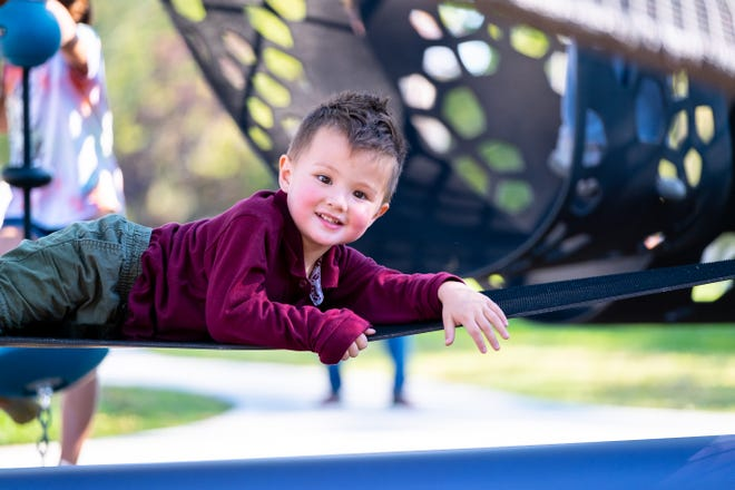 Kanon Burns, 3, plays on the new Quantis Climber Tuesday, Sept. 28, 2021, at Palmer Park in Port Huron.  A ribbon cutting ceremony was held for the new play equipment Tuesday.