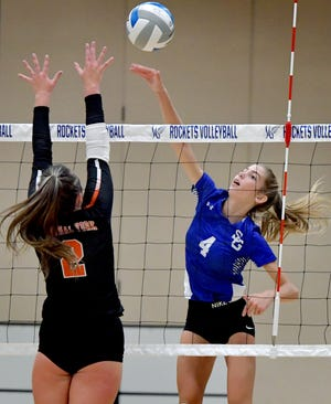 Spring Grove's Hailey Wolfe, seen here at right in a file photo, had 14 kills and six assists on Monday in a 3-0 win over West York.