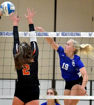 Spring Grove's Mylie Ormond launches a shot as Central York's Abbey Stiffler attempts to block in girls' volleyball at Spring Grove Tuesday, Sept. 28, 2021. Bill Kalina photo