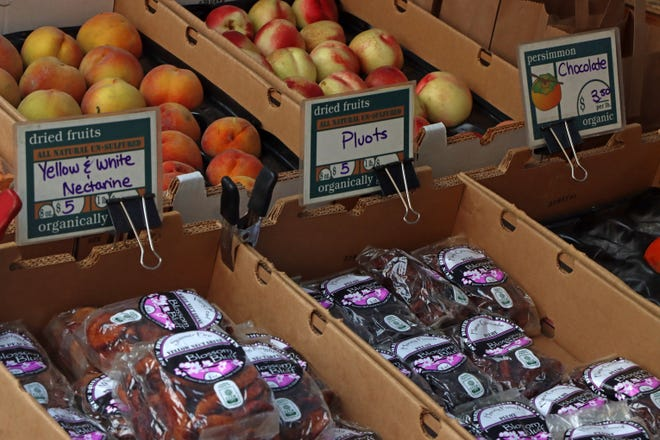 Fresh fruit and vegetables are just some of the items for sale at the Downtown Visalia's Certified Farmers Market, held each Thursday evening.