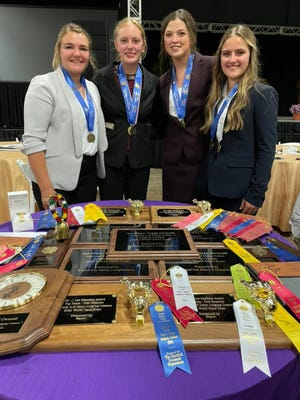 Members of the international competition-bound Manitowoc County 4-H dairy cattle judging team include Emma Vos, Jenna Gries, Lauren Siemers and Clarissa Ulness. The team won national honors this week at World Dairy Expo and are coached by Angie Ulness and Paul Siemers.