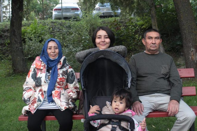 Fatema Hosseini, center, with her mother, Masuma, father, Sayed Amin and little sister Mobina in a park in Kyiv after they were reunited safely in Ukraine.