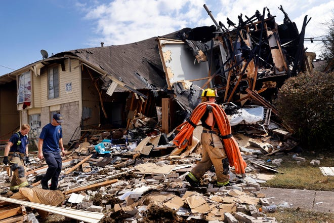 Members of Dallas Fire and Rescue work on scene following an apartment explosion and fire on Highland Hills Drive in southeast Dallas, Wednesday, Sept. 29, 2021. A natural-gas explosion tore apart the building injuring people and firefighters who arrived on scene to investigate the smell of natural gas.