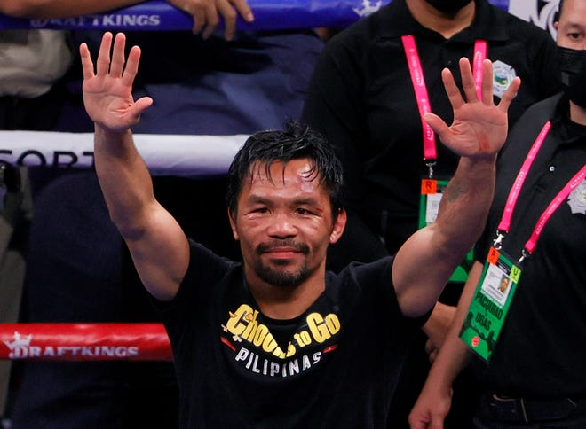 Manny Pacquiao, seen here waving to the fans after his loss to Yordenis Ugas in August, has announced his retirement from boxing.