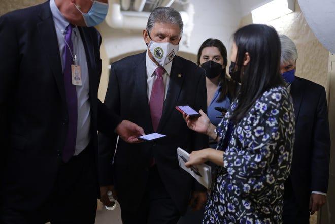 Sen. Joe Manchin, D-W.Va., talks to reporters in a hallway at the U.S. Capitol on Sept. 28, 2021 in Washington, D.C.