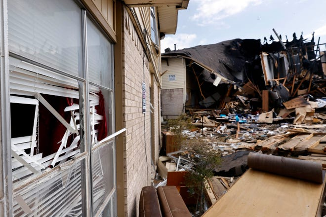 Blown out windows are seen in adjacent building following an apartment explosion on Highland Hills Drive in southeast Dallas, Wednesday, Sept. 29, 2021. A natural-gas explosion tore apart the building injuring people and firefighters who arrived on scene to investigate the smell of natural gas.