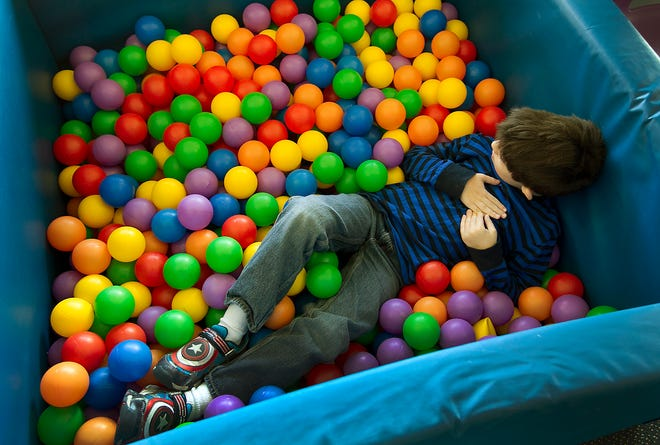 A child plays in the ball pit in the motor lab of the Foundation School for Autism in San Antonio. New studies have found that 78% of kids with autism also have been diagnosed with a mental health condition.