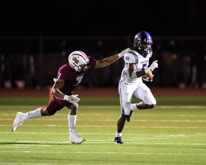 Cedar Ridge's Victor Taylor Jr. eludes Round Rock's Trayvien Brown during the Raiders' District 25-6A win two weeks ago. Taylor averages almost 18 yards per touch.