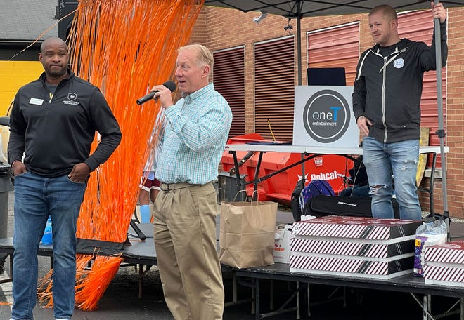 Cuyahoga Falls Mayor Don Walters speaks to attendees and exhibitors at the Cuyahoga Falls Chamber of Commerce's Fall for the Falls Community event in the Cuyahoga Falls High School parking lot on Sept. 25. The event was a rebranded version of the community expo.