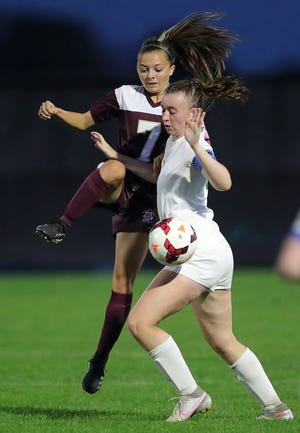Stow's Payton Benci, left, kicks the ball around Nordonia's Maddie Wasielewski during the first half of a soccer game, Wednesday, Sept. 29, 2021, in Stow, Ohio.