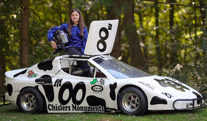 Lily Impellizzeri, 12, poses for a portrait with her bandolero racecar in Munroe Falls.