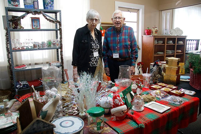 Bargains in the Belfry volunteers Shirley and David Oehling pose with some of the holiday items available on Thursday, Sept. 30, 2021. Shirley has been volunteering in Bargains in the Belfry for about 14 years, while David began volunteering about nine years ago following his retirement.