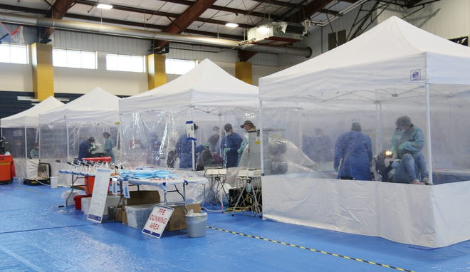 Volunteer dentists, dental assistants, and students from The Dental College of Georgia provide free dental care, including dental fillings and dental extractions, to people in need at the RAM Free Clinic in Louisville.