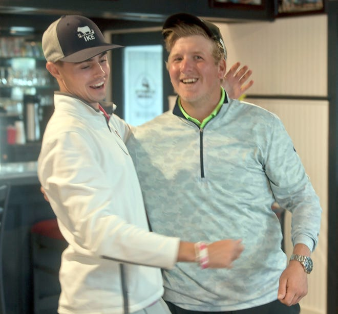 HYANNIS    09/30/21   Pro winner Anthony Sebastianelli of Summit, Pa. (right) and Amateur winner Nick Piersall of Portland, Ct. gather in the clubhouse at the Cape Cod Open final at the Hyannis Golf Course.