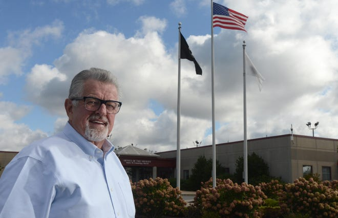 Sheriff James Cummings, standing at the entryway to the Barnstable County Correctional Facility in Bourne on Thursday has announced he will not run for reelection in 2022. He will have served 24 years.