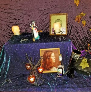 Each year at Samhain, known as Halloween by non-pagans, Columbia's Conclave of the Craft creates an altar of ancestors for the harvest holiday celebration. The altar is meant to venerate those who have died, whether family or friends, with photos, food and various pagan faith-related symbols.