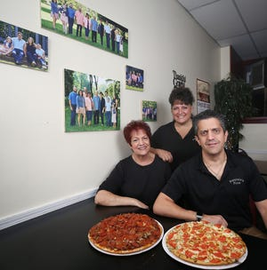 Sylvia Francisco (left) is pictured with her daughter, Lisa Preston, and son, Anthony Francisco. They and Sylvia's husband, Jim, own and run Pasquales Pizza, 558 W. Schrock Road in Westerville. Pasquale's has been business for 32 years.