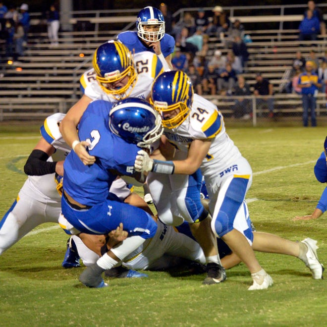 Southwestern Randolph's Colton Law (24) and Grayson Teague (52) tackle Asheboro's Michael Brady during a Sept. 24 game. This week, the Cougars host Wheatmore and the Blue Comets host Central Davidson.