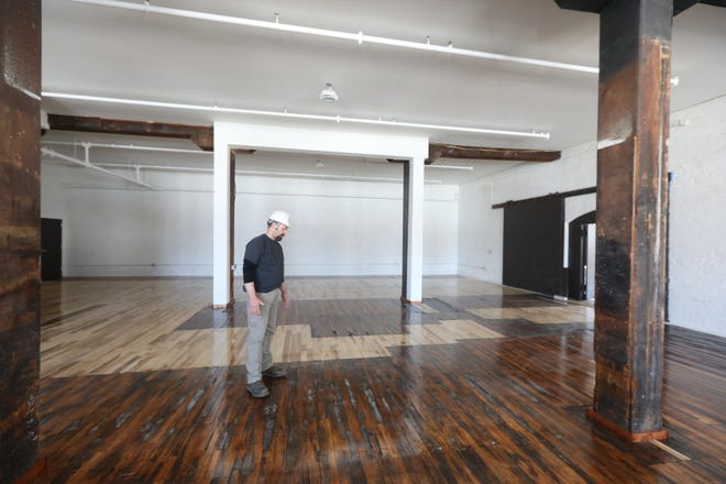 Troy Stender, of Green Star Construction of Davenport, stands amid some of the 15,000 square feet of commercial space at 425 Valley St. in downtown Burlington in this January photo. Downtown Partners is hosting a Commercial Space Open House for people interested in relocating, expanding or opening a business in downtown Burlington on Sunday.