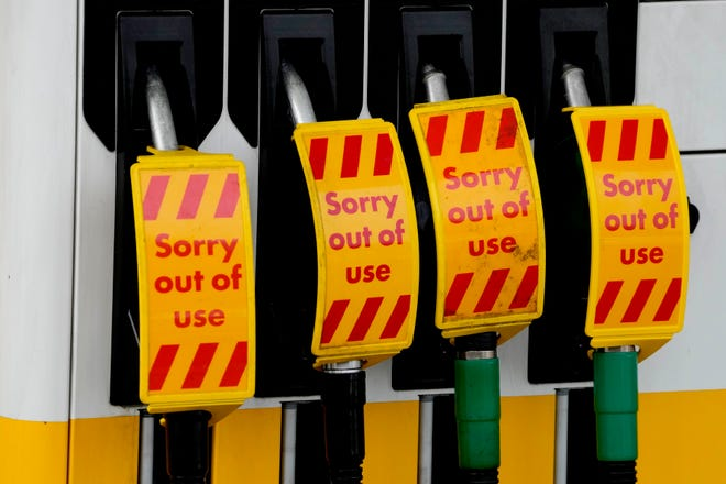 Closed fuel pumps at a petrol station in London, Tuesday, Sept. 28, 2021. Long lines of vehicles have formed at many gas stations around Britain since Friday, causing spillover traffic jams on busy roads.