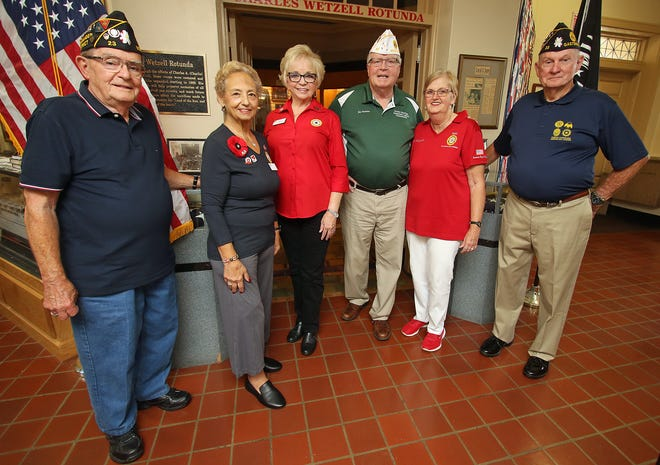 Jim Mayo, Toni Reale, Jill Puett, James and Linda Quinlan and John Ackles with Post 23 pose together inside the American Military Museum of Gastonia on West 2nd Avenue in Gastonia.