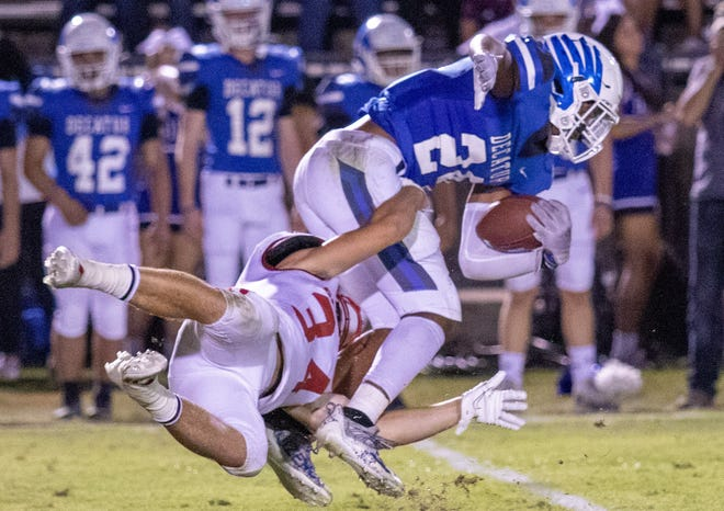 Glen Rose's Tristan Black goes airborne in stopping a Decatur ball carrier in the Tigers' 41-21 win over the Eagles on Friday night.