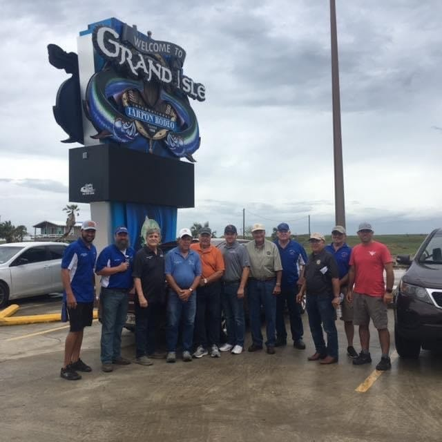 Gonzales Mayor Barney Arceneaux, along with the Jambalaya Festival Association, put together a group to travel to Grand Isle. Pictured, from left, are: Cade Lanoux, Bart Himel, City of Gonzales Mayor Barney Arceneaux, Town of Grand Isle Mayor David Camardelle, David Guitreau, Preston Landry, Johnny Berthelot, Wally Taillon, Kenny Matassa, Doty Gautreau, and Dale LeBlanc.