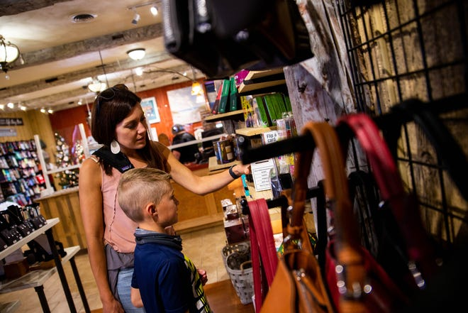 Rachel and Ben Wolfe browse the shelves at Apothecary Gift Shop on Thursday, Sept. 30. The store, located at 35 W. Eighth St. in downtown Holland, carries a variety of gifts and decorations.