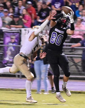 Rosepine's Cole Donahue (80) goes up for one of his six catches in last week's win over Sacred Heart.