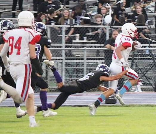 East Beauregard running back Caleb Johnson breaks free for a touchdown during a recent game. The Trojans host Gueydan in district play at 7 p.m.