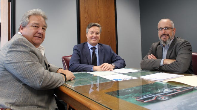 Greece Town Supervisor Bill Reilich and Scott Copey, director of planning and economic development, meet with Phil Fitzsimmons and Billy Owens from Paneffort to discuss the town's ongoing support as they move toward locating in the old Sam's location at Elmridge Plaza.