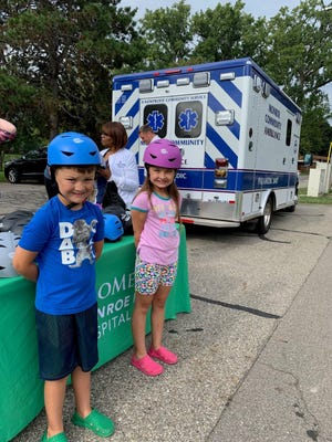 With a grant from the Bureau of EMS, Trauma & Preparedness, ProMedica Monroe Regional Hospital and Monroe County Ambulance purchased and distributed 96 bicycle helmets earlier this month. Courtesy photo