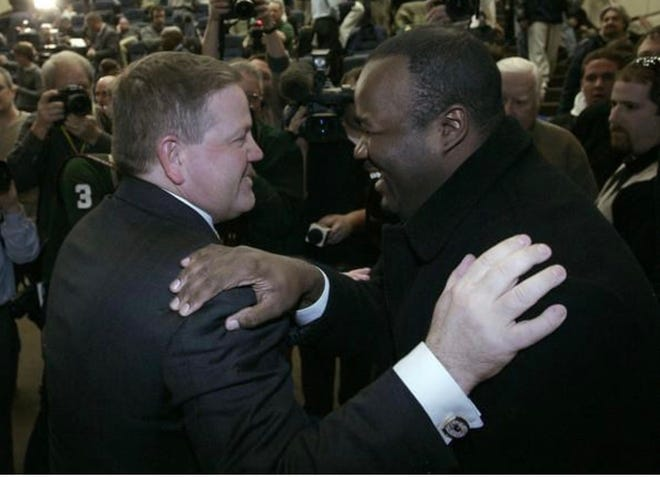 Brian Kelly (left) reunites with one of his former players at Grand Valley State, Ira Childress, during Kelly's introductory press conference as Notre Dame's head football coach, Dec. 11, 2009, at the Guglielmino Athletics Complex.