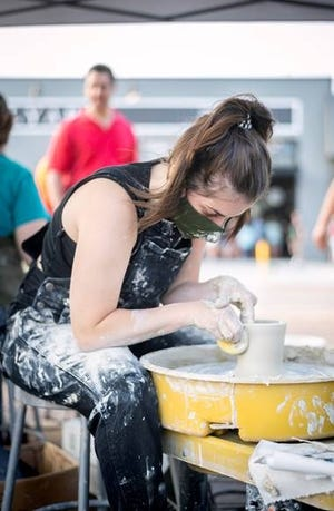Amelia Synan throws pottery during a demonstration at the August VIBES event.