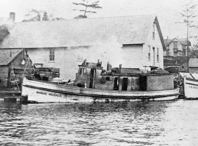 Tug Minnie Warren bringing a huge barge into Round Lake, September 1871.