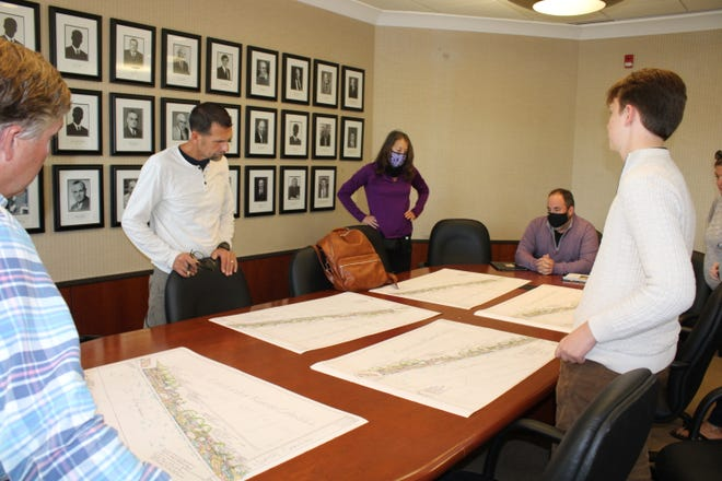 Charlevoix DDA board members look at plans for landscaping along the Pine River Channel presented by Leilani Durbin from Silver Linings Charlevoix.