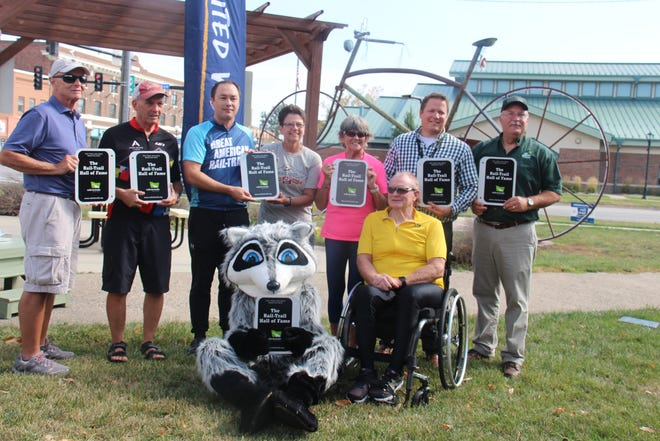Members of the Raccoon River Valley Trail Association board pose for a photo to help induct the RRVT into the Rail-Trail Hall of Fame on Thursday, Sept. 30, 2021, in Perry.