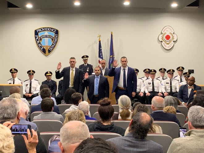 Newly promoted officers, from left, Detective Kyle Endres, Detective Kyle Richards and Detective Christopher Beach at a promotions ceremony Thursday.