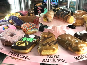 A selection of doughnuts in a case at Voodoo Doughnut in downtown Eugene.