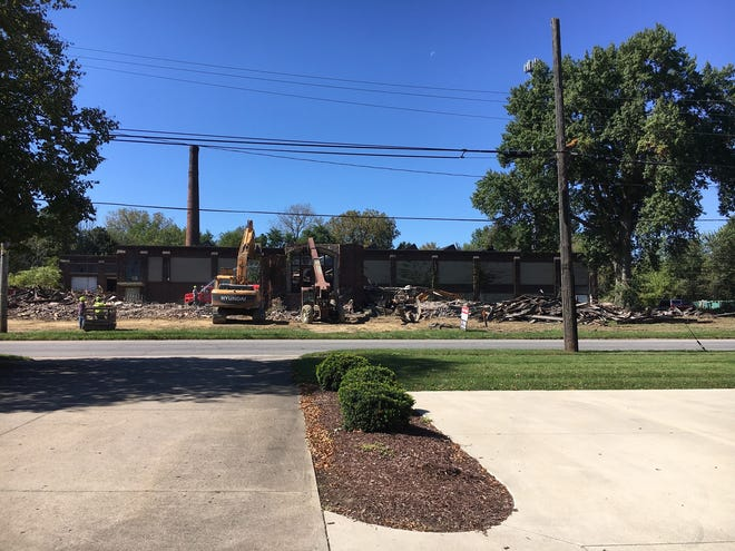 The former McCaskey Register building in Alliance is being torn down.