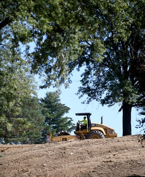 Heavy machinery, seen from Kirby Avenue NE, looking east, has been leveling what was Skyland Pines Golf Club on Columbus Road in Canton. Plans filed with Canton's Building Department show a warehouse will be built at the site. The company that will use the warehouse hasn't been named, but many expect it will be an Amazon facility.