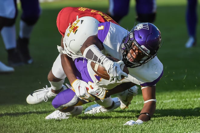 Northern Iowa Panthers wide receiver Deion McShane (1) stretches for extra yardage against Iowa State Cyclones defensive back T.J. Tampa (25) in the second half at Jack Trice Stadium.