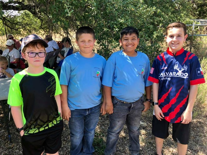 Several members of the Erath 4-H Shooting Sports Club recently competed at the Glen Rose 3D shoot. Pictured are Travis Freese; Hayden Harris, third place, open competition aided; Rhett Reed; and Ryder Simms, first place, competition aided.