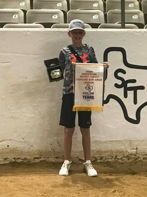 Barrett Wood, with Erath 4-H Shooting Sports Club, shows the awards he won recently at the State Fair of Texas. Wood took first place in junior compound archery.