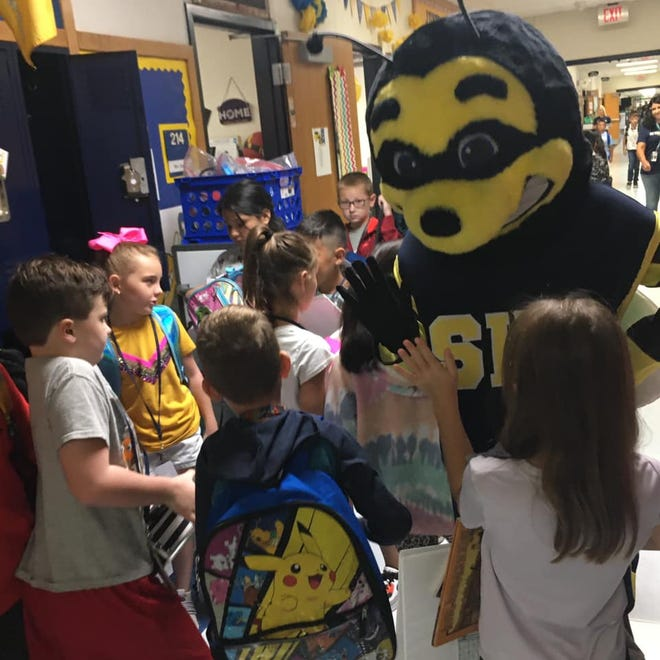 The Stephenville High School Yellow Jackets and Honey Bees mascot Buzz made a stop at Hook Elementary School this week to greet students.
