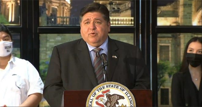 Gov. JB Pritzker announces the distribution of the first $24 million in Back to Business, or B2B, grants during a news conference Thursday in Chicago.